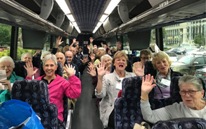 members on bus waving