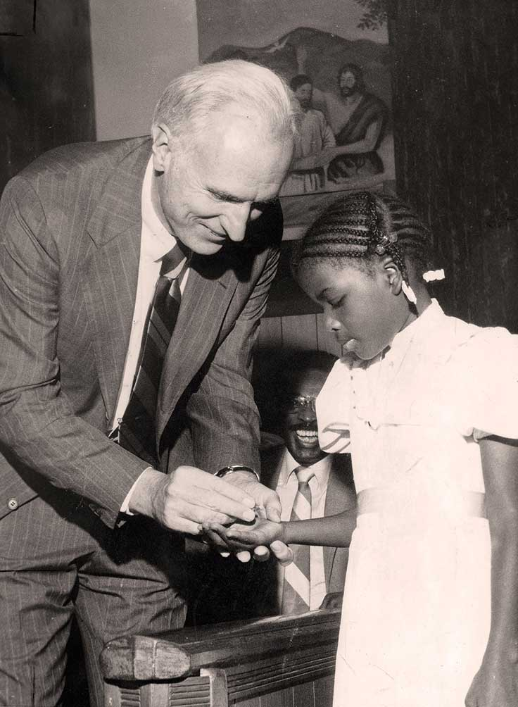 Beatreia Burgess, age eight, receives an award from Hudnut during a Youth Service Sunday.