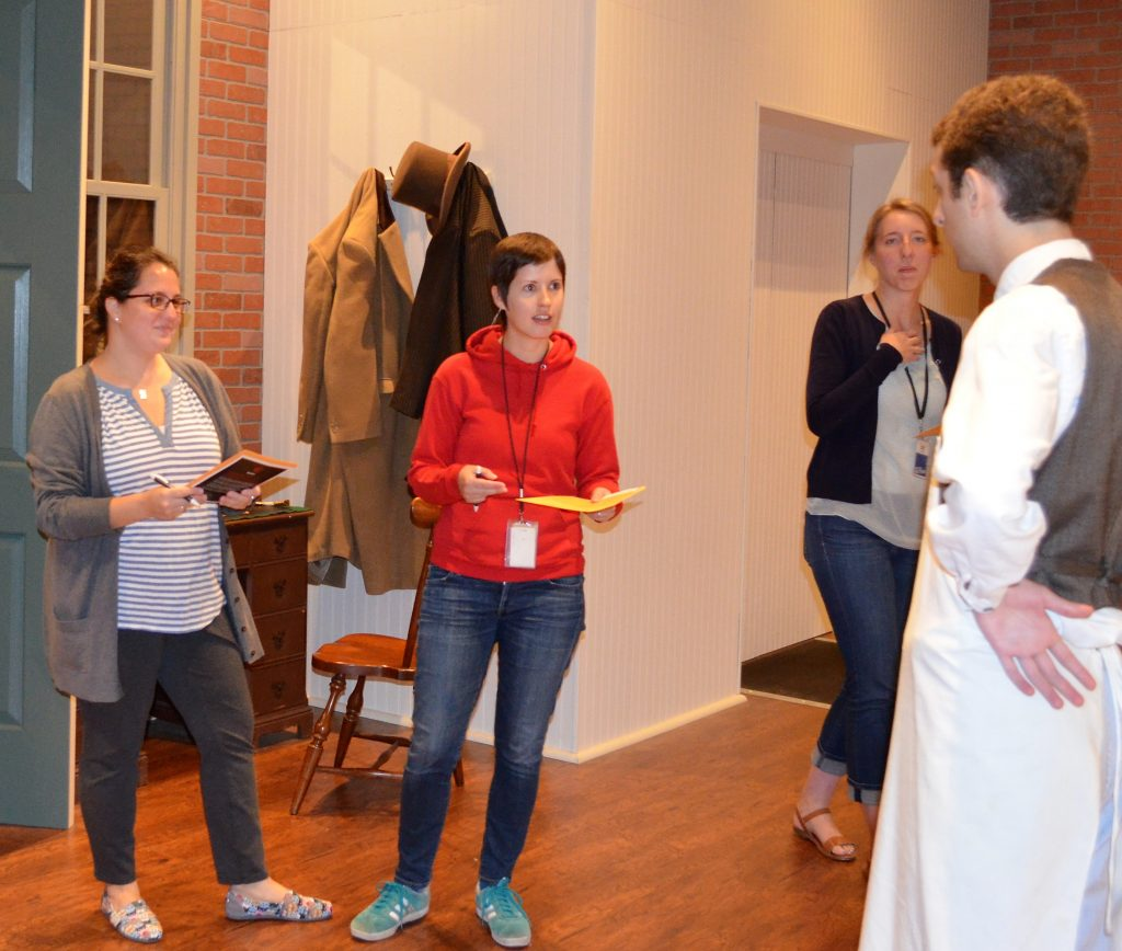 A couple of our staff members questioning a (guilty?) suspect during last year's rehearsal.