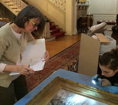 Conservators examine painting